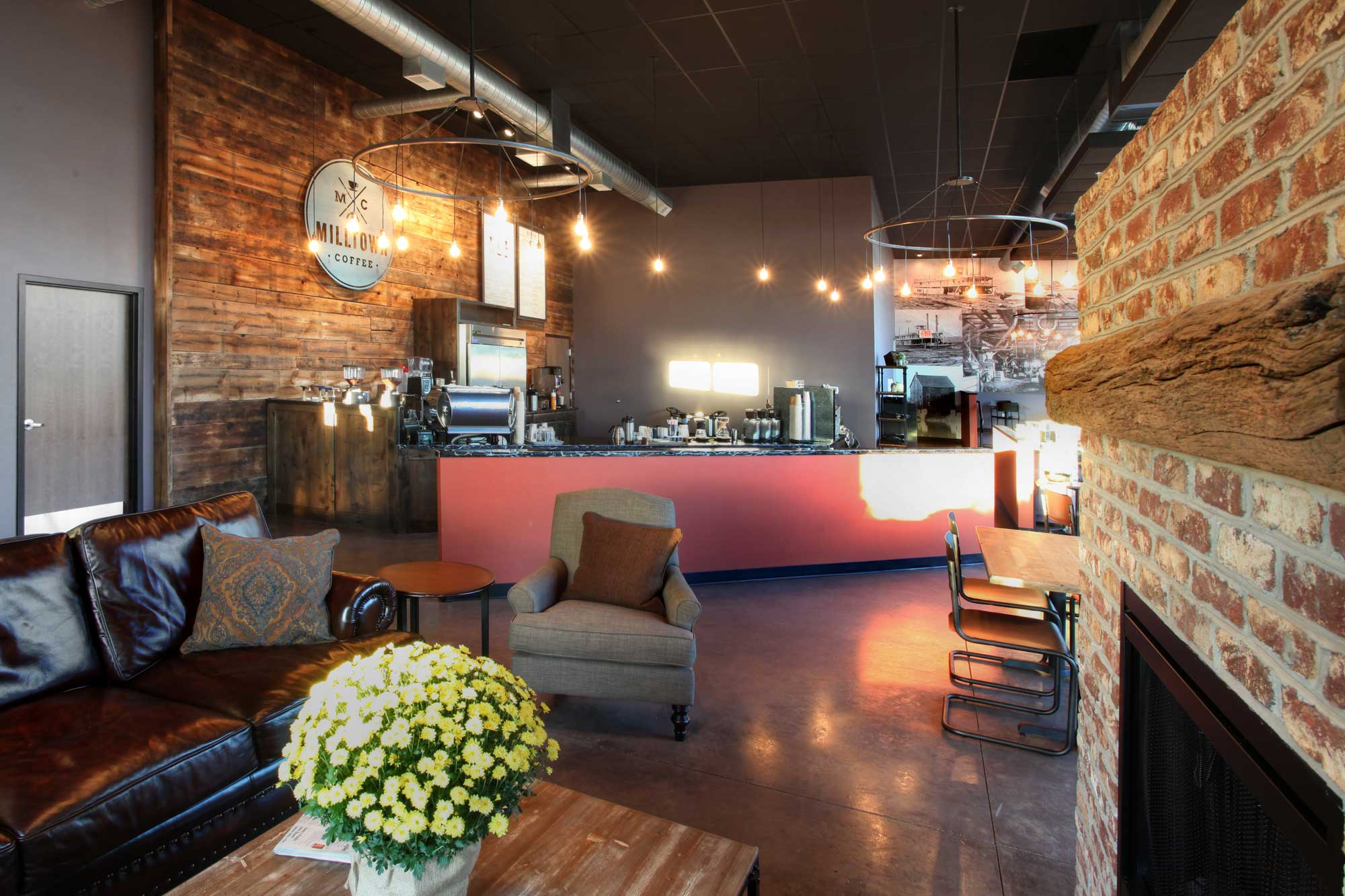 Feature of Milltown Coffee restful lounge area with fireplace and couch