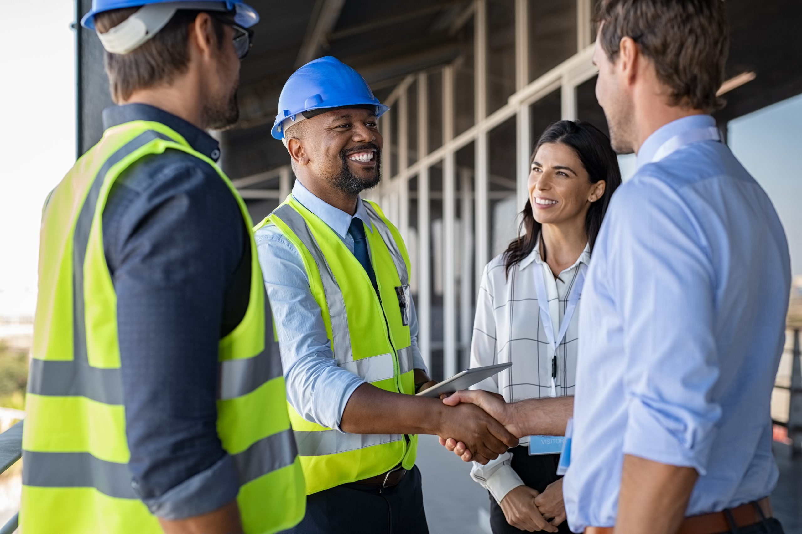 Engineer and businessman shake hands at construction site